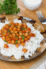 white rice with chickpeas in tomato sauce