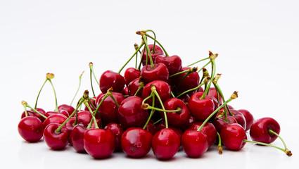 Sweet Cherry heap on white background