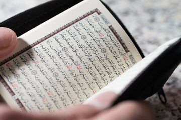 Close-up Muslim Man Reading Koran