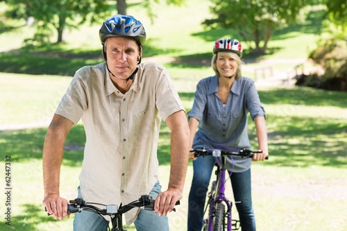 Couple bike riding in park