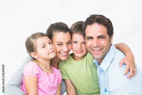 Cute family smiling at camera together