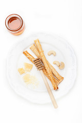 Grissini bread sticks with parmesan cheese and honey
