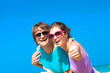 Portrait of happy young caucasian couple in sunglasses having