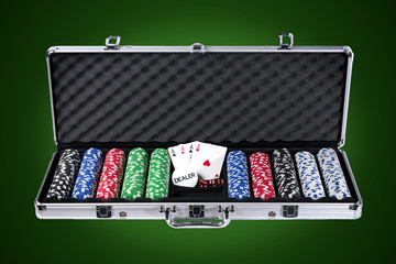 Poker case with chips and cards with path on green background