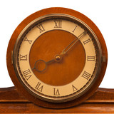 vintage clock with roman numerals closeup