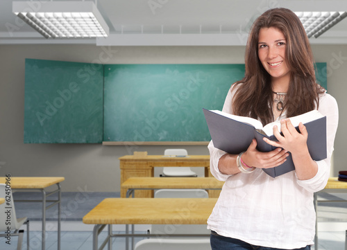 Female student  with open book