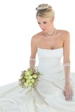 Elegant bride holding flower bouquet