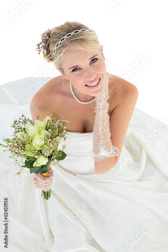 Portrait of smiling bride holding flower bouquet