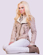 Beautiful fashionable blonde girl in jacket