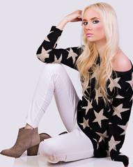 Beautiful fashionable girl in sweater
