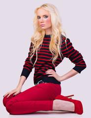 Beautiful fashionable blonde girl in sweater