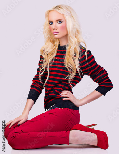 Beautiful fashionable blonde girl in sweater