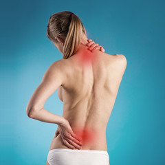 Woman suffering from lumbago or back pain