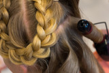Hairdresser makes braids