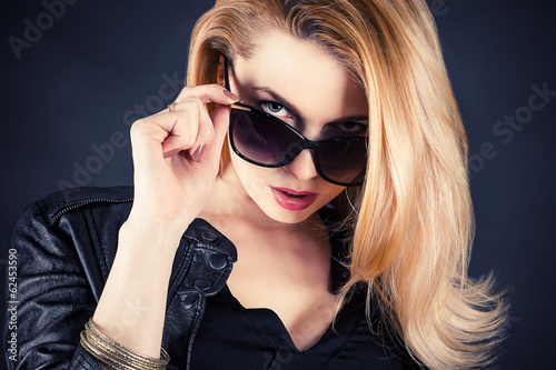 sexy woman look through sunglasses
