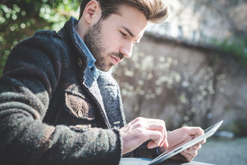 young handsome fashion model using tablet man
