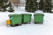 Green recycling containers in the winter park