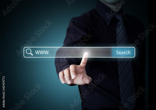 Hand pressing Search button, Internet technology concept