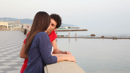 Young Couple Talking and Kissing