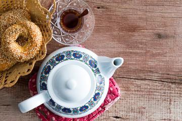 Pot of tea with a fresh Turkish sesame bagel