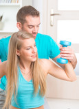 Woman with personal trainer at home