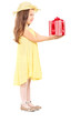 Full length portrait of cute little girl holding a present