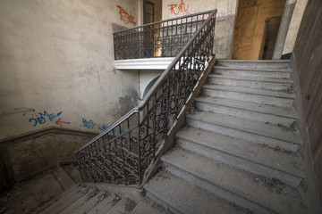 Internal staircase in old abandoned mansion