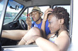 Black couple sitting in a parking lot