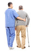 Male nurse helping an elderly gentleman