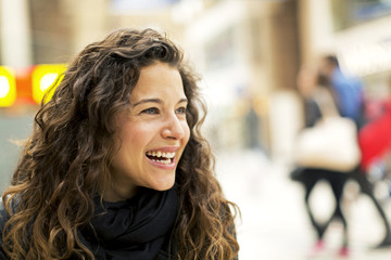 Portrait of a young attractive woman laughing
