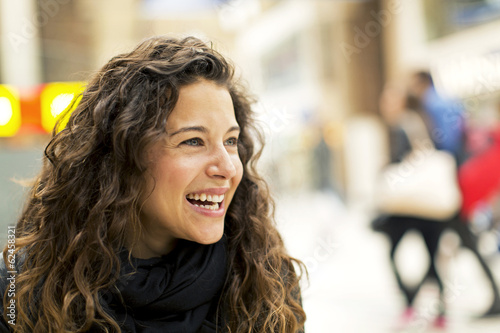 canvas print picture Portrait of a young attractive woman laughing