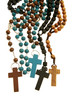 Many different wood rosaries or necklaces united on white