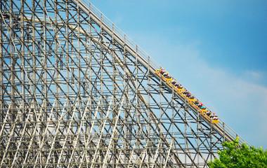 huge wooden roller coaster and sky in background