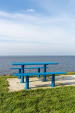 Steel picnic table at Dutch coast with room for copy space