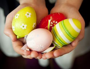 Hands Holding Colorful Easter Eggs