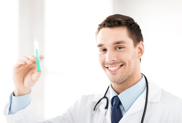male doctor holding syringe with injection