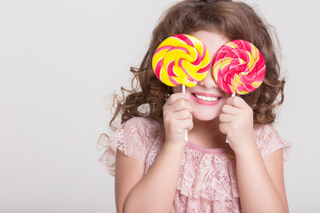 Funny child eat candy lollipop Funny baby girl eating sweets