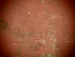 Muro rosso rovinato di una casa
