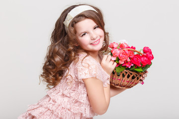 Little child girl with spring flowers