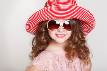 Summer portrait of little girl in hat and sumgalsses