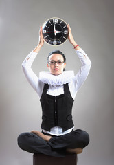 Business lady in ruff collar with a clock