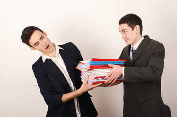 Unhappy worker receiving a lot of paper work from his happy boss