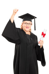 Mature student holding a diploma and gesturing happiness