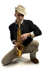 young man playing saxophone