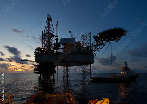 Oil and gas platform with beautiful sky during sunset