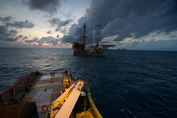 An offshore vessel (AHTS) towing the oil and gas platform