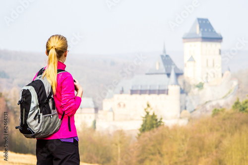 Young girl with Karlstejn on background