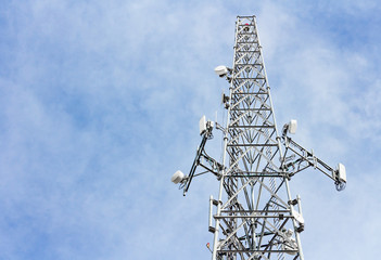 Steel cellphone tower structure,blue sky with clouds.