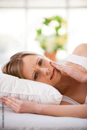 Woman suffering from toothache.