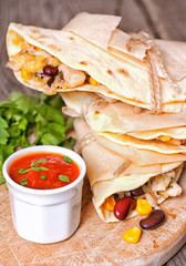 Tortillas with chicken, beans, corn and cheese
